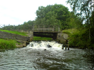The river Siesartis. The dam of Siesartis watermill